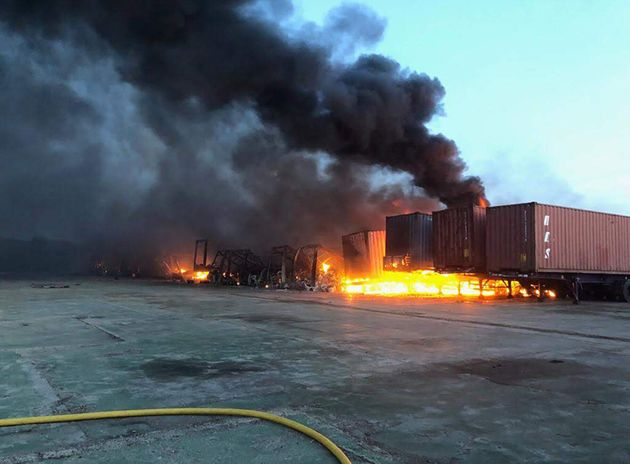Cambridgeshire Fire and Rescue Service handout photo of containers on fire as firefighters battle a large...