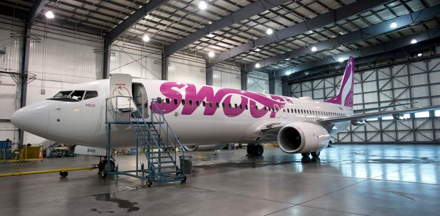 A Boeing 737-800 jetliner belonging to Swoop inside a hangar for maintenance in Edmonton, Alta., Thurs....