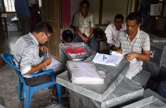 Workers at the National Register of Citizens office check documents submitted by people for the NRC ahead...