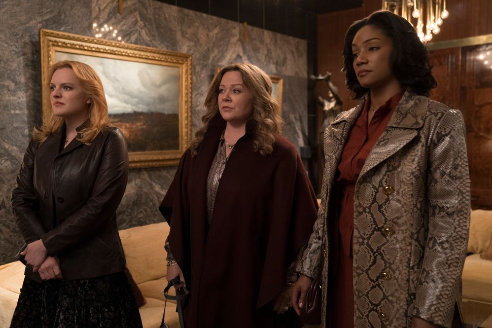 "Elisabeth Moss, Melissa McCarthy and Tiffany Haddish in ""The Kitchen."""