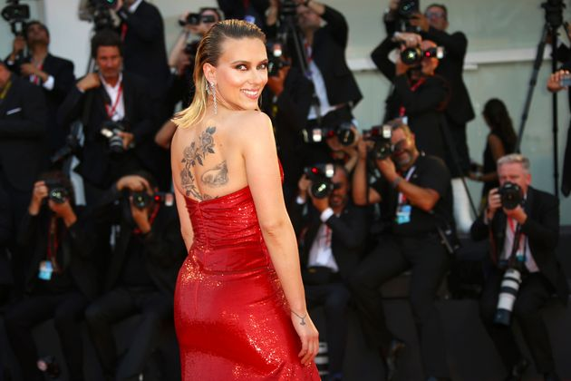 Actress Scarlett Johansson poses for photographers upon arrival at the premiere of the film 'Marriage...