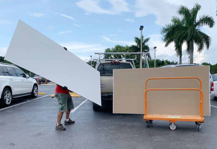 Shoppers prepare ahead of Hurricane Dorian at The Home Depot on Thursday, Aug. 29, 2019, in Pembroke Pines, Fla.