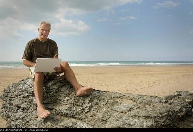 Male on a beach using his