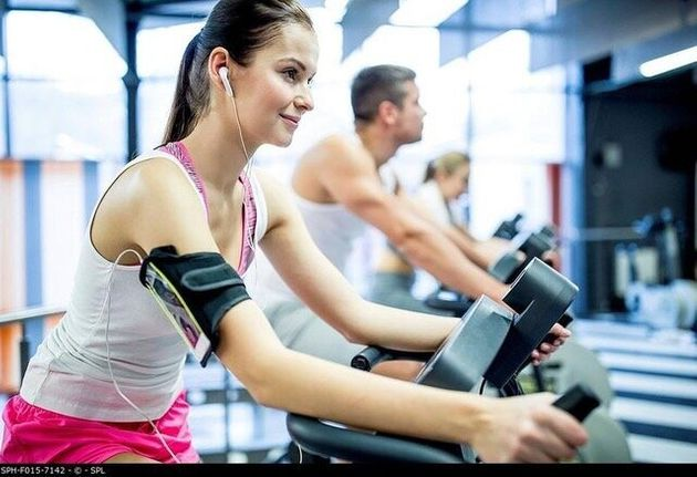 Young woman listening to music while working out in