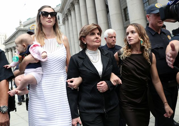 Gloria Allred, representing alleged victims of Jeffrey Epstein, leaves with Teala Davies and an unidentified...