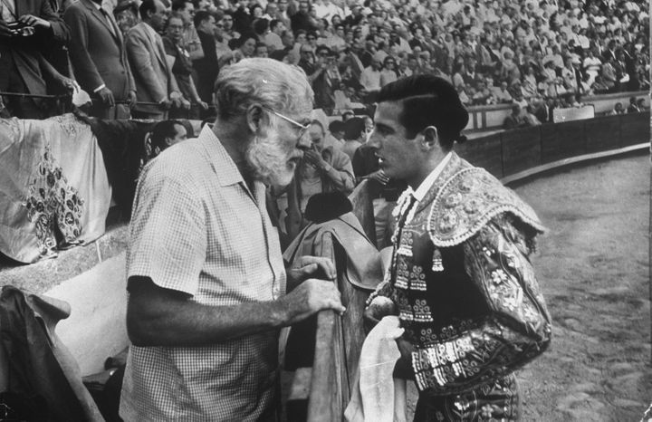 Spanish matador Antonio Ordonez (R) chatting w. his friend, author Ernest Hemingway, in arena before bullfight. (Photo by Loomis Dean/The LIFE Picture Collection via Getty Images)