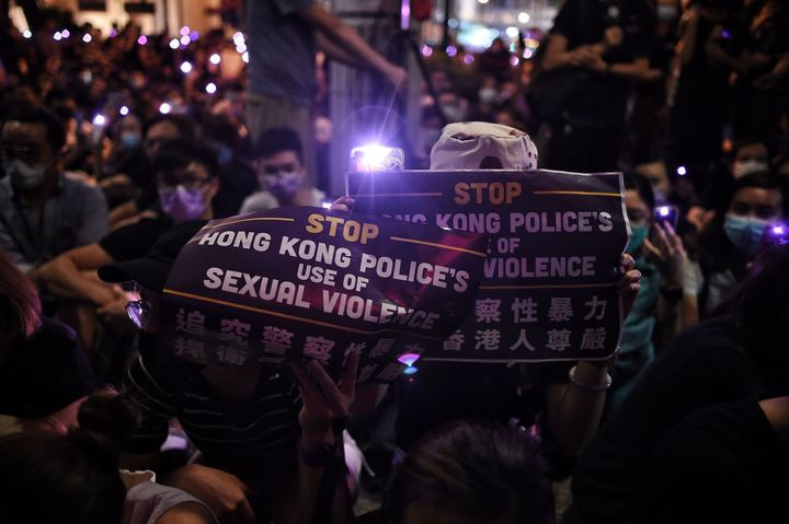 People take part in a #MeToo rally in Hong Kong on August 28, 2019, to protest alleged sexual assaults by police against anti