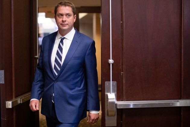 Federal Conservative Leader Andrew Scheer arrives for a news conference in Toronto, on Aug. 29,