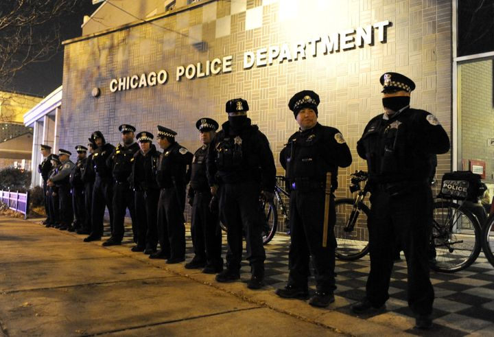 In this Nov. 24, 2015, file photo, Chicago police officers line up outside the District 1 central headquarters in Chicago, du