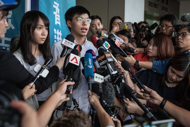 HONG KONG, CHINA - AUGUST 30: Hong Kong pro-democracy activists Agnes Chow (L) and Joshua Wong speak...