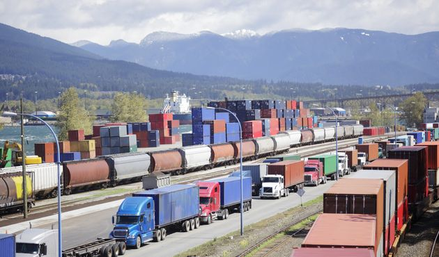 Freight containers being loaded onto flatbed trucks at the Port of Vancouver. Statistics Canada says...