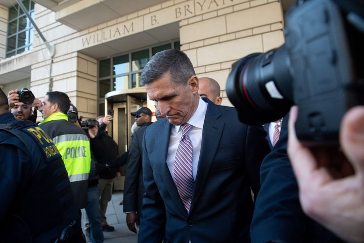 Former National Security Advisor General Michael Flynn leaves after the delay in  his sentencing hearing at US District Court