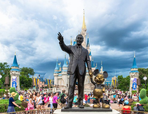 Walt Disney and Mickey Mouse statue inside of the Magic Kingdom at Disney
