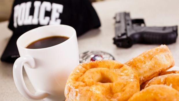 Coffee and donut break for policeman  Can't get much better.