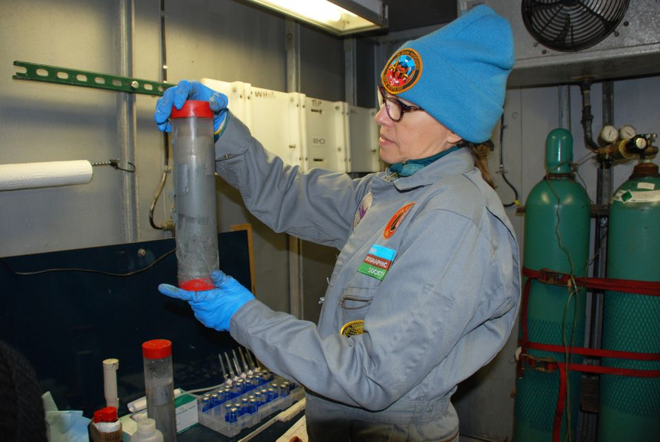 Samantha Joye inspects a core of marine sediment aboard