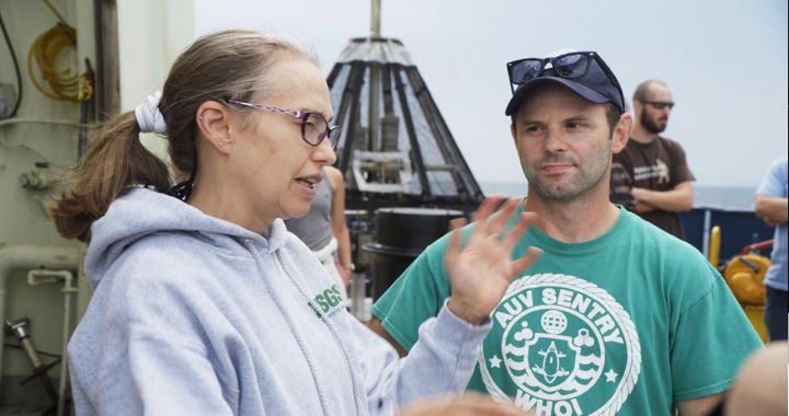 Oceanographer Samantha Joye and deep-sea ecologist Erik Cordes chat aboard the research vessel Atlantis in August 2018.