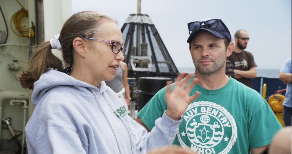 Oceanographer Samantha Joye and deep-sea ecologist Erik Cordes chat aboard the research vessel Atlantis in August 2018.