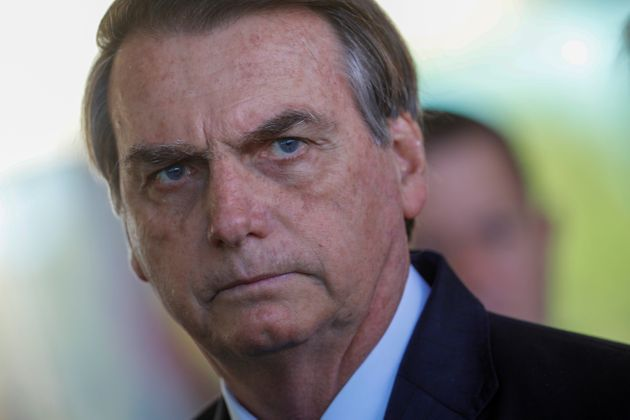 Brazil's President Jair Bolsonaro looks on during a news conference in Brasilia, Brazil, on August