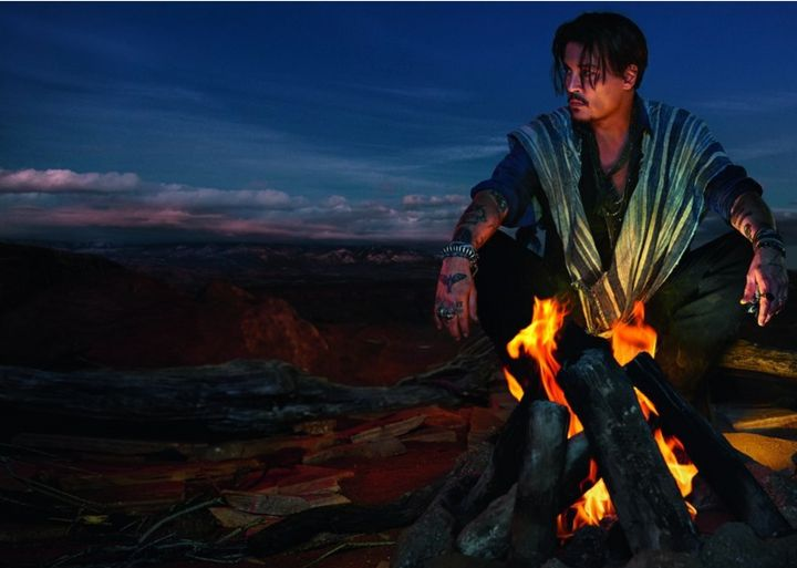 """A promotional still for the fragrance """"Sauvage"""" featuring actor Johnny Depp."""
