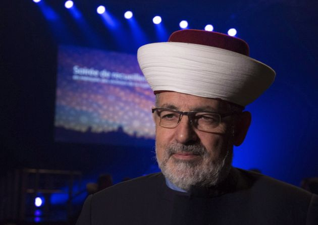 Imam Hassan Guillet arrives at a gathering at the Pavillon de la Jeunesse, marking the first anniversary...