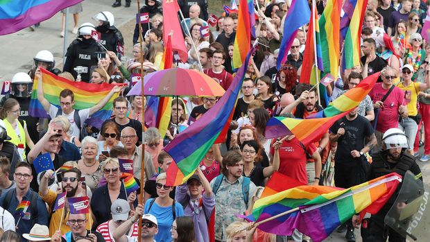LGBT activists and their supporters gather for the first-ever pride parade in the central city of Plock, Poland, on Saturday, Aug. 10, 2019. The parade comes as the country finds itself bitterly divided over the growing visibility of the LGBT issue and as the government and powerful Catholic church denounce gay rights as a threat to society. (AP Photo/Czarek Sokolowski)