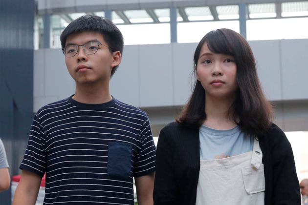 In this June 18, 2019, photo, pro-democracy activists Agnes Chow, right, and Joshua Wong meet media outside...