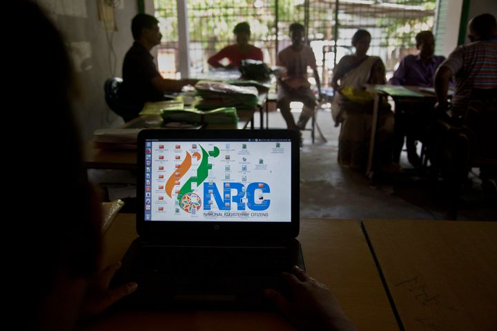 National Register of Citizens (NRC) officers attend to people in an NRC center on the eve of the release of the final NRC draft on the outskirts of Gauhati, India, Friday, Aug. 30, 2019. India on Saturday, Aug. 31 plans to publish a controversial citizenship list that advocates say will help rectify decades of unchecked illegal immigration into the northeastern state of Assam from Bangladesh. Critics fear it will leave off millions of people, rendering them stateless. (AP Photo/Anupam Nath)