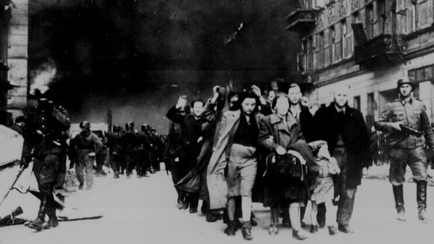 Jewish civilians are led down a street by German soldiers during the destruction of the Warsaw Ghetto, in Poland, 1943.    U.S. National Archives/via REUTERS   ATTENTION EDITORS - THIS IMAGE HAS BEEN SUPPLIED BY A THIRD PARTY