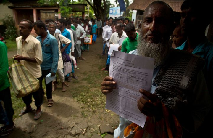 People whose names were left out in the National Register of Citizens (NRC) draft stand in a queue to collect forms to file appeals near a NRC center on the outskirts of Gauhati, India, Monday, Aug. 13, 2018. A draft list of citizens in Assam, released in July, put nearly 4 million people on edge to prove their Indian nationality. (AP Photo/Anupam Nath)