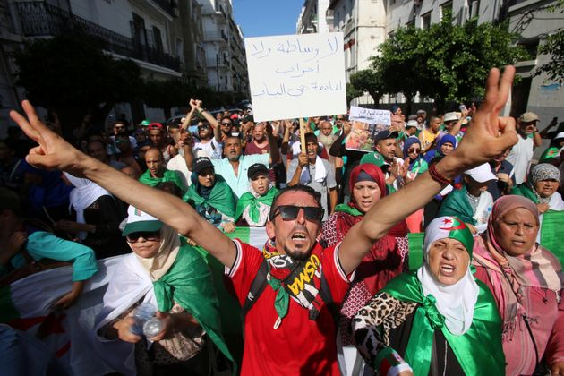 Demonstrators shout slogans and gesture during a protest demanding social and economic reforms, as well...