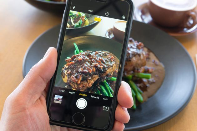 Melbourne, Australia - Oct 20, 2017: Taking picture of beef steak with smartphone