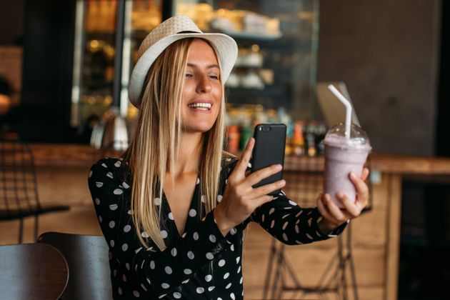 Blogger Woman Takes Milkshake Photo