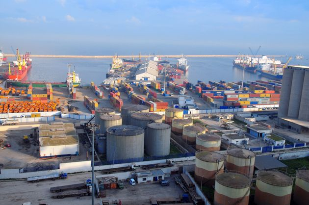 Oran, Algeria - January 27, 2008: fuel storage and container harbor - container ships and isotainer