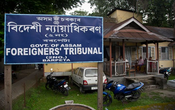 In this Aug. 28, 2019, photo, people wait at the Foreigner's Tribunal office in Barpeta, in the northeastern Indian state of Assam. India plans to publish a citizenship list in the northeastern state of Assam on Saturday, Aug. 31, that advocates hope will help rectify decades of illegal immigration from Bangladesh. Critics of the list worry it will leave millions of people stateless, leading to detention or deportation. Some cases have even led to suicide. (AP Photo/Anupam Nath)