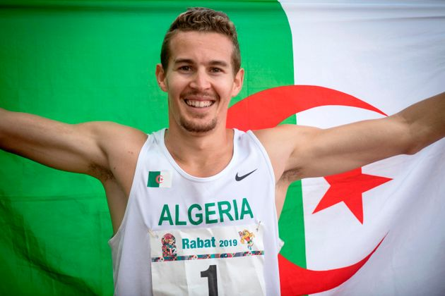 Algeria's Abdelmalik Lahoulou waves a national flag after competing during the Men's 400m Hurdles Final...