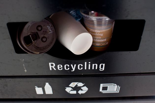 A recycling bin is stuffed with coffee cups on Yonge Street in downtown