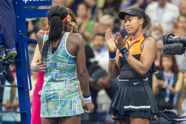 Naomi Osaka, right, claps for a teary Coco Gauff as they give an interview to ESPN after round three...