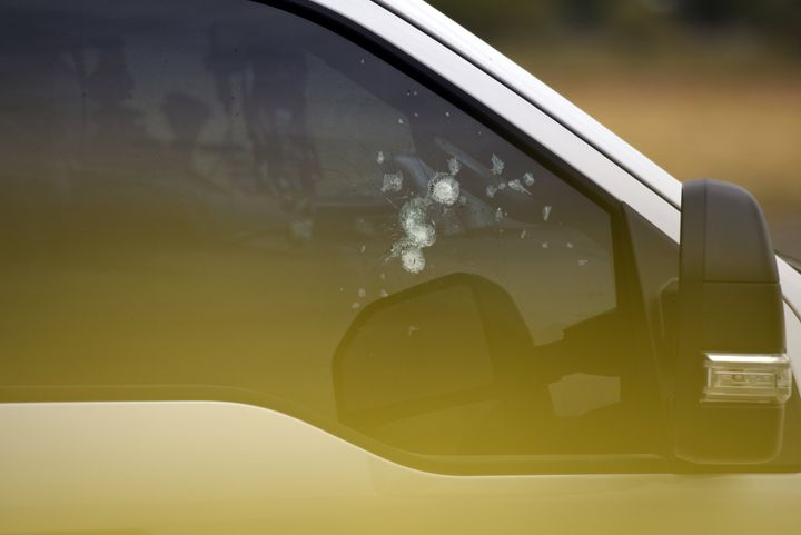Bullet holes are seen in a car window near an Olive Garden restaurant following Saturday's shooting in Odessa, Texas.