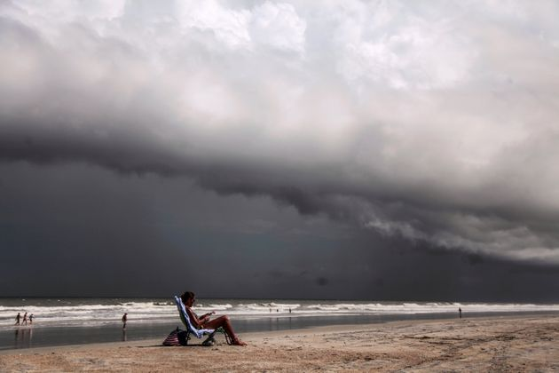 Tricia Cheshire, a resident of Amelia Island sunbathes for the last few minutes before storms hit the...