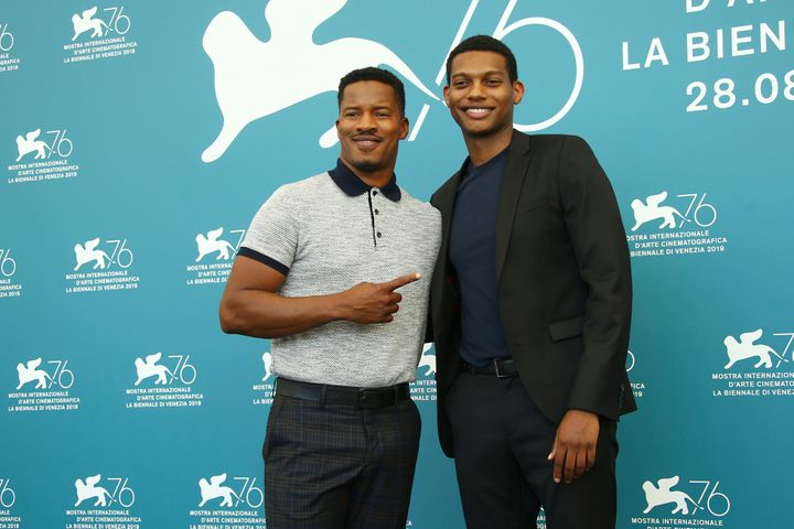 Director Nate Parker, left, and actor Shane Paul McGhie pose for photographers at the photo call for the film 'American Skin'
