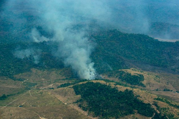 Smoke rises from a rainforest in Altamira, Para state, Brazil, Wednesday, Aug. 28, 2019. Brazilian President...
