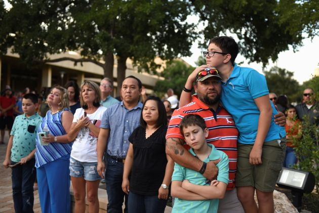 People gather for a vigil following Saturday's shooting in Odessa, Texas, U.S. September 1, 2019. REUTERS/Callaghan