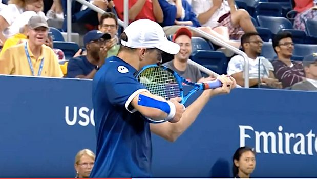Doubles player Mike Bryan pretends to shoot line judge at U.S. Open