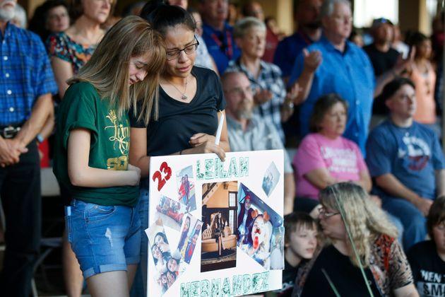High School students Celeste Lujan, left, and Yasmin Natera, right, mourn their friend Leila Hernandez,...