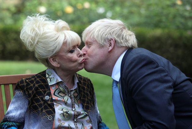 Prime minister Boris Johnson kisses Dame Barbara Windsor at the end of their