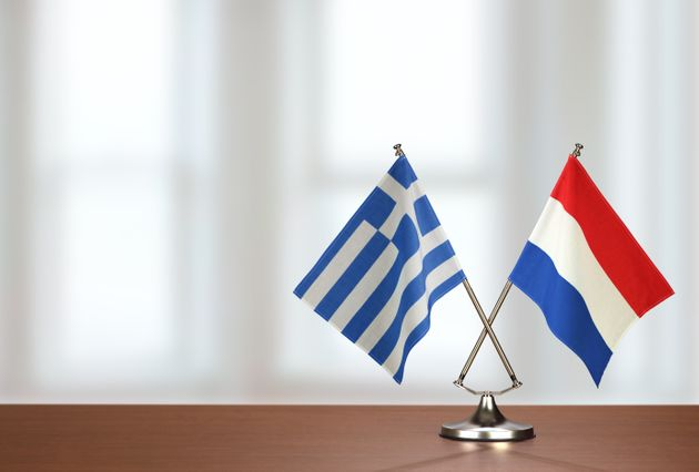 Two crossed national flags on wooden