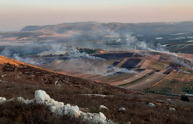 Smoke rises from Israeli army shells that landed in the southern Lebanese border village of Maroun Al-Ras,...