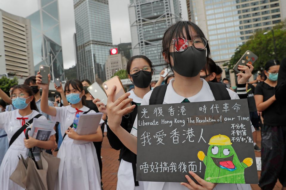 A student wears an eye patch to show solidarity with a woman injured by a police projectile during a...