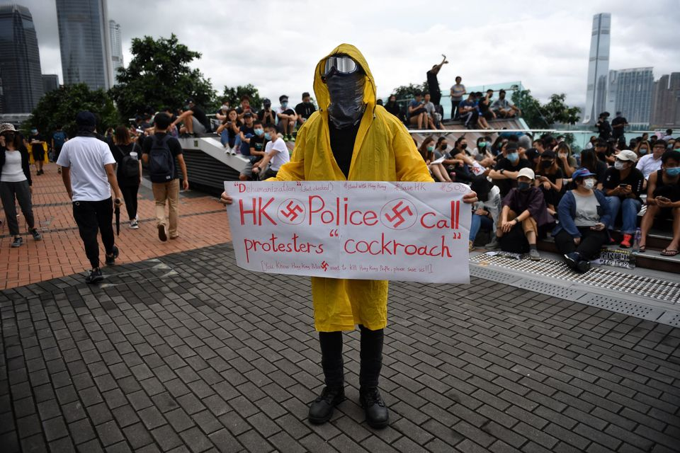 TOPSHOT - A protester holds a sign during a rally at Tamar Park in Hong Kong on September 2, 2019, in...