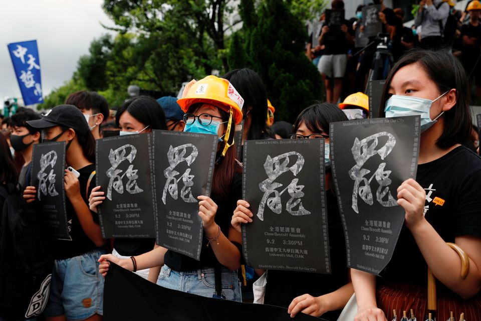 Students boycott their classes as they take part in a protest against the extradition bill at the Chinese...